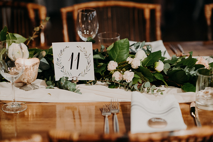 paper table numbers - photo by Scarlet ONeill https://ruffledblog.com/industrial-space-meets-enchanted-forest-wedding