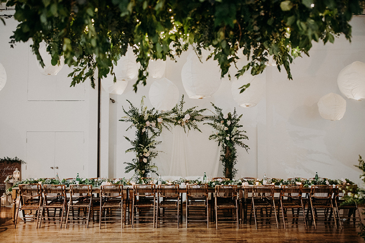 modern romantic wedding receptions - photo by Scarlet ONeill http://ruffledblog.com/industrial-space-meets-enchanted-forest-wedding
