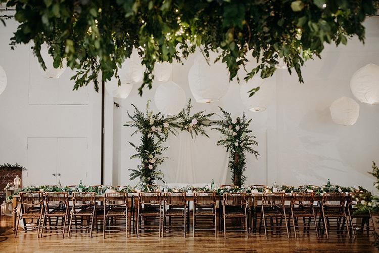 modern romantic wedding receptions - photo by Scarlet ONeill https://ruffledblog.com/industrial-space-meets-enchanted-forest-wedding