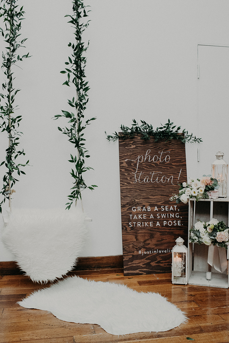 photo booth ideas - photo by Scarlet ONeill https://ruffledblog.com/industrial-space-meets-enchanted-forest-wedding