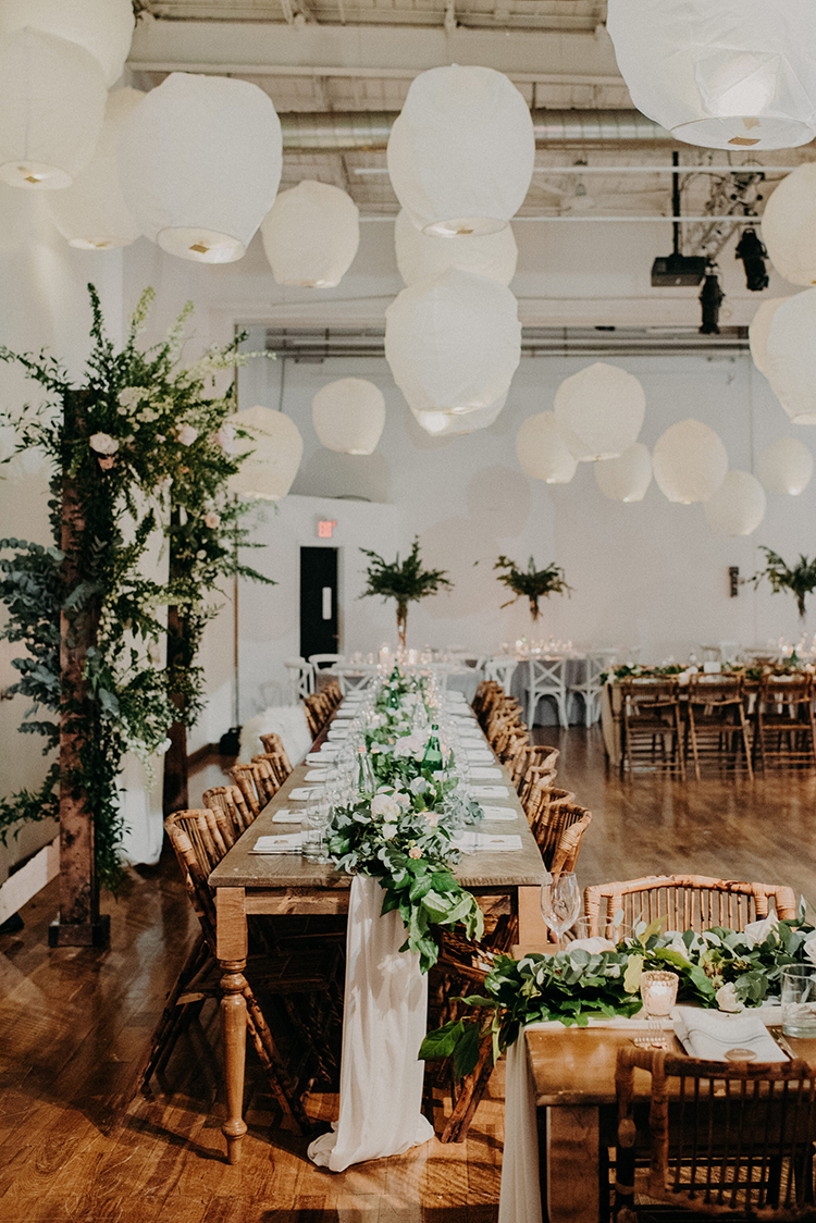 white paper lanterns at weddings - photo by Scarlet ONeill https://ruffledblog.com/industrial-space-meets-enchanted-forest-wedding