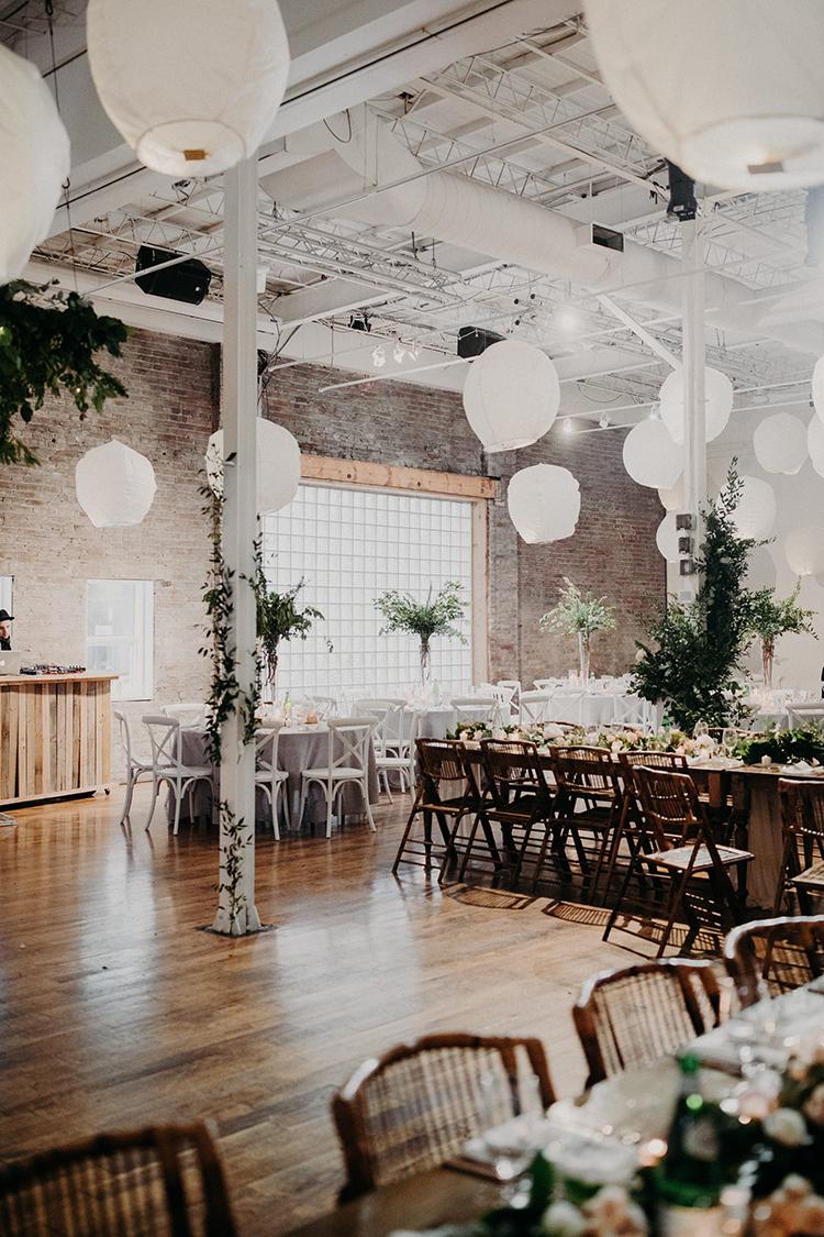 modern industrial wedding ideas - photo by Scarlet ONeill http://ruffledblog.com/industrial-space-meets-enchanted-forest-wedding