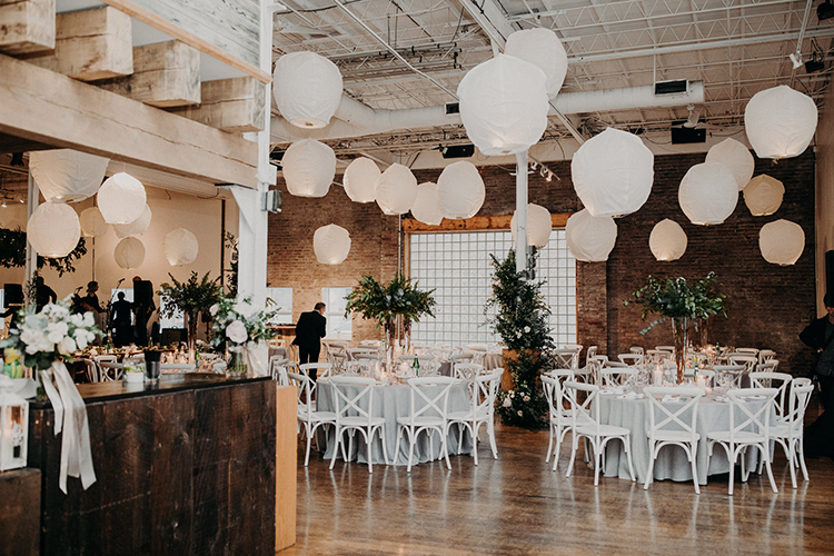 wedding receptions with white paper lanterns - photo by Scarlet ONeill http://ruffledblog.com/industrial-space-meets-enchanted-forest-wedding