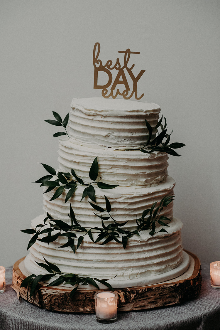 best day ever cake toppers - photo by Scarlet ONeill http://ruffledblog.com/industrial-space-meets-enchanted-forest-wedding