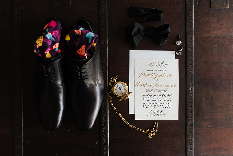 groom accessories and wedding invitations - photo by Mango Studios http://ruffledblog.com/industrial-wedding-in-toronto-with-an-enchanted-forest-reception