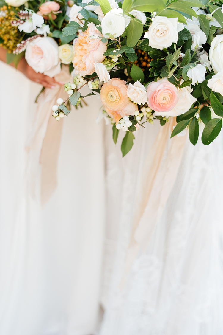 romantic bridesmaid bouquet ideas - photo by Mango Studios https://ruffledblog.com/industrial-wedding-in-toronto-with-an-enchanted-forest-reception