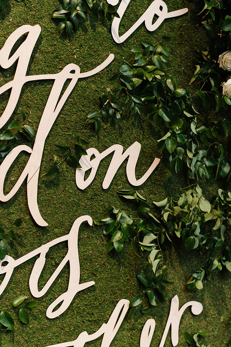 greenery sign ceremony backdrops - photo by Mango Studios https://ruffledblog.com/industrial-wedding-in-toronto-with-an-enchanted-forest-reception