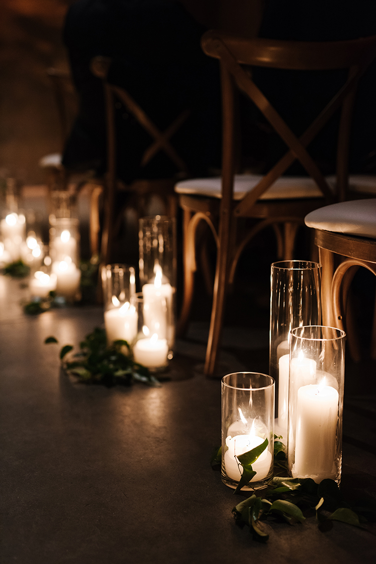 ceremony lighting - photo by Mango Studios http://ruffledblog.com/industrial-wedding-in-toronto-with-an-enchanted-forest-reception