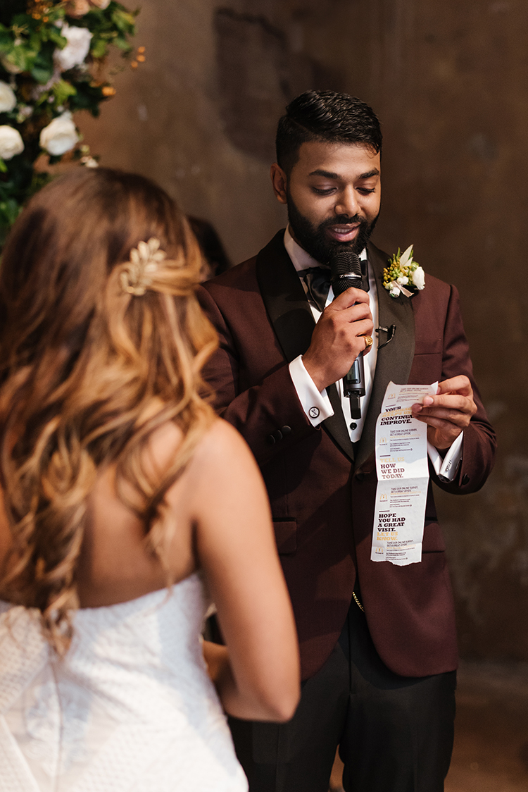 groom reading vows off of receipt - photo by Mango Studios https://ruffledblog.com/industrial-wedding-in-toronto-with-an-enchanted-forest-reception