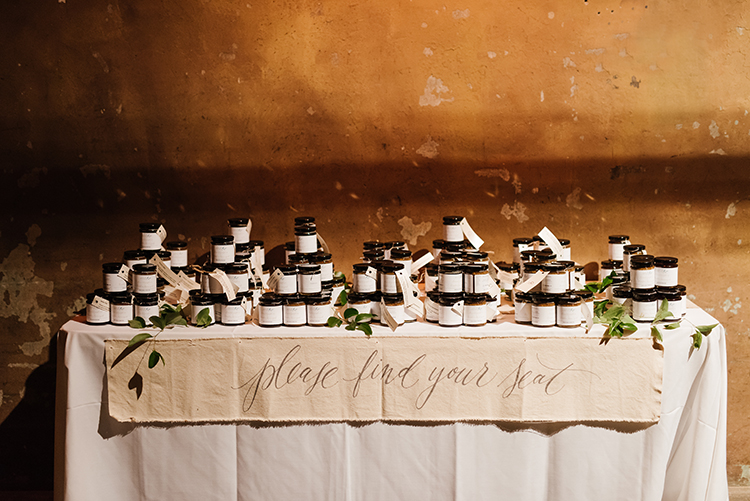 wedding favors and escort cards - photo by Mango Studios https://ruffledblog.com/industrial-wedding-in-toronto-with-an-enchanted-forest-reception