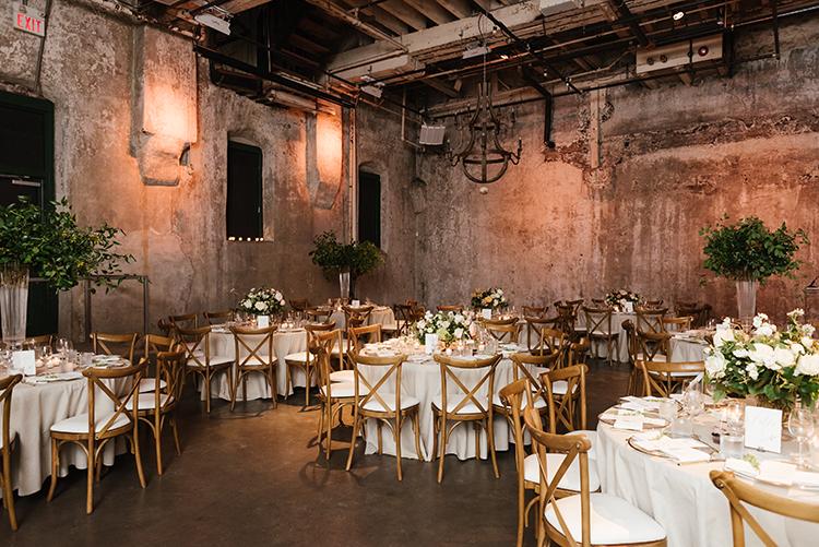 industrial wedding receptinos - photo by Mango Studios https://ruffledblog.com/industrial-wedding-in-toronto-with-an-enchanted-forest-reception