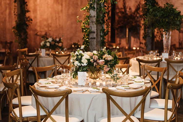 wedding tables - photo by Mango Studios http://ruffledblog.com/industrial-wedding-in-toronto-with-an-enchanted-forest-reception