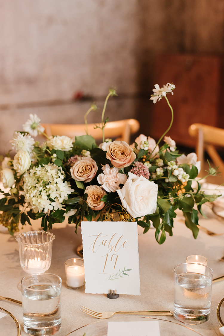 dusty pale pink wedding centerpieces - photo by Mango Studios http://ruffledblog.com/industrial-wedding-in-toronto-with-an-enchanted-forest-reception