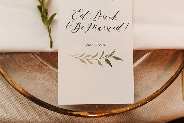 place setting paper goods - photo by Mango Studios http://ruffledblog.com/industrial-wedding-in-toronto-with-an-enchanted-forest-reception