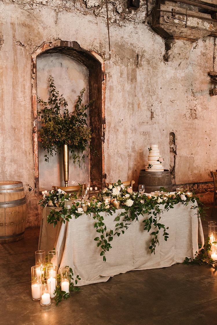 wedding sweetheart tables - photo by Mango Studios https://ruffledblog.com/industrial-wedding-in-toronto-with-an-enchanted-forest-reception