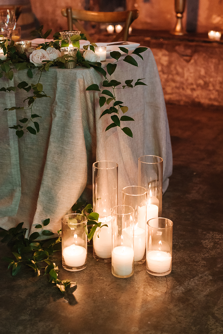 sweetheart table ideas - photo by Mango Studios https://ruffledblog.com/industrial-wedding-in-toronto-with-an-enchanted-forest-reception