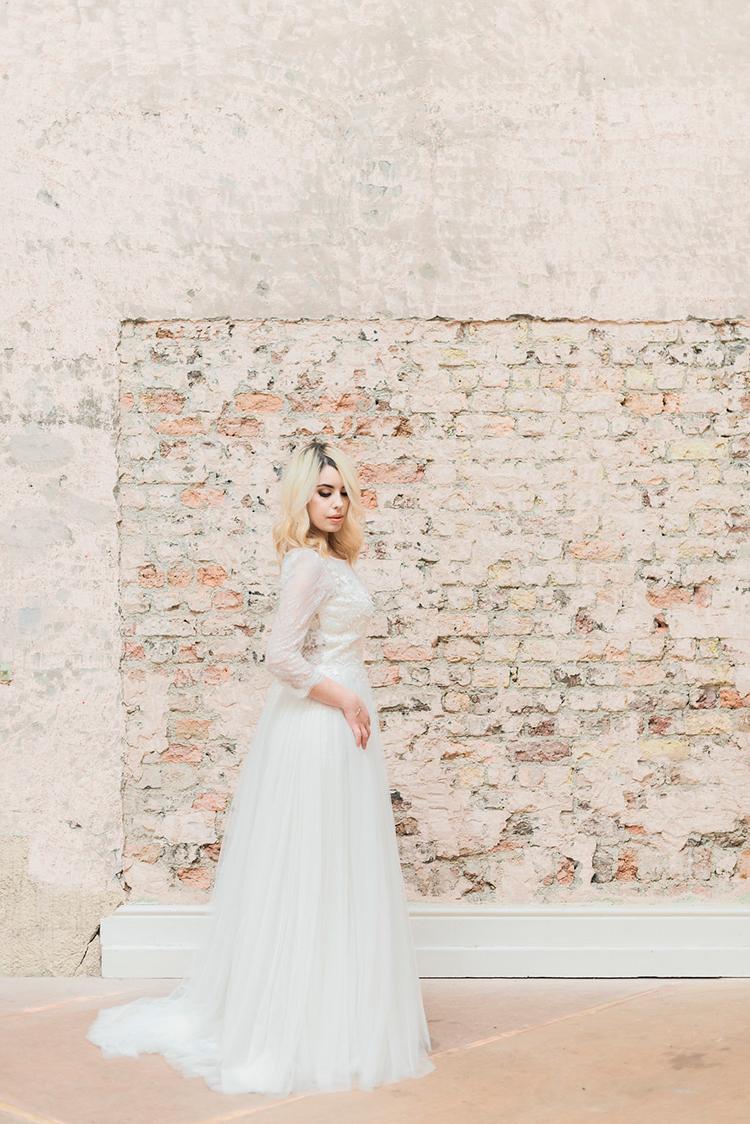 gauzy wedding dresses - photo by Studio Brown http://ruffledblog.com/industrial-wedding-shoot-in-dublin-with-serious-romantic-vibes
