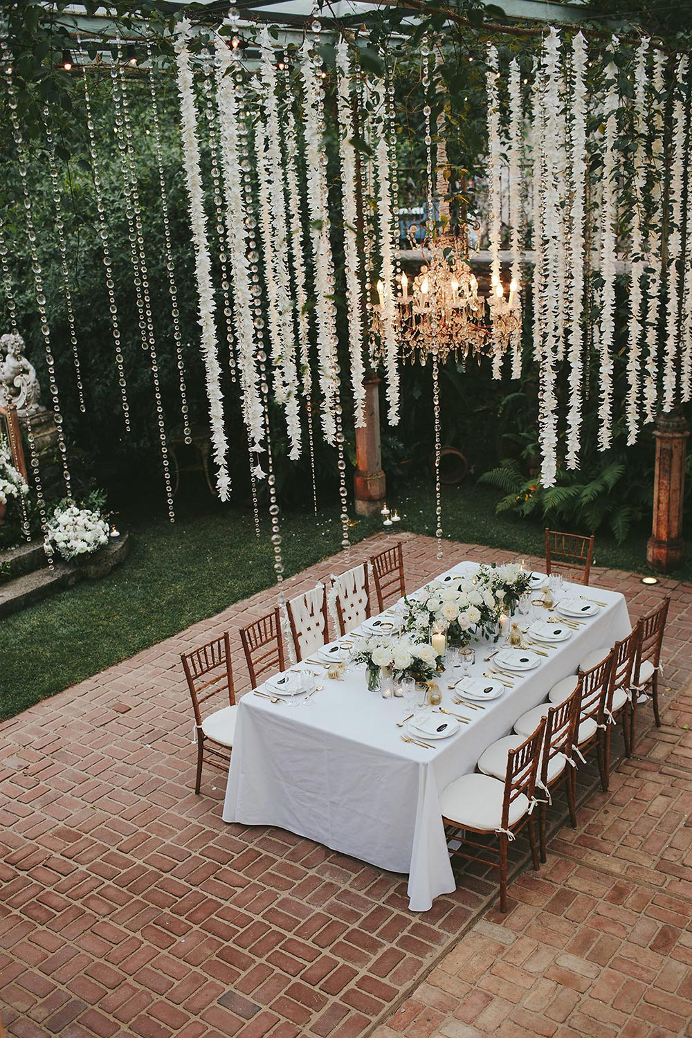 al fresco Maui wedding reception with orchids and crystals