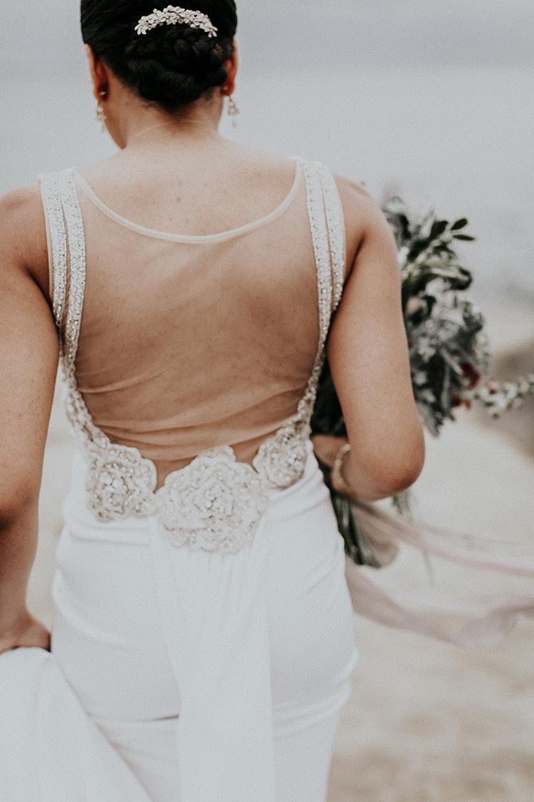 romantic wedding dress back details - https://ruffledblog.com/intimate-modern-romantic-wedding-celebration-the-ceremony