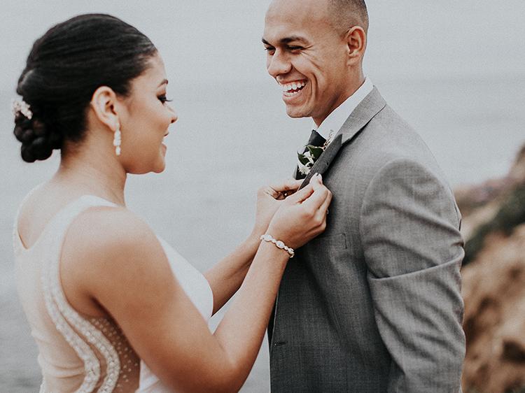 bride pinning the grooms boutonniere - https://ruffledblog.com/intimate-modern-romantic-wedding-celebration-the-ceremony