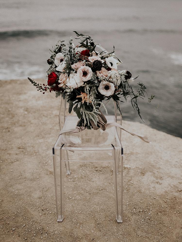 moody anemone bouquets - https://ruffledblog.com/intimate-modern-romantic-wedding-celebration-the-ceremony