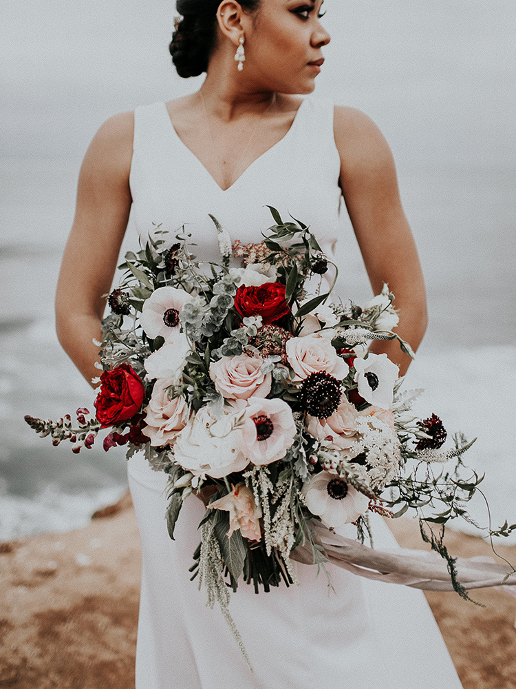 romantic moody bouquet with anemones - https://ruffledblog.com/intimate-modern-romantic-wedding-celebration-the-ceremony