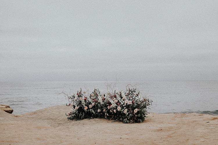waterside wedding ceremony floral arrangements - https://ruffledblog.com/intimate-modern-romantic-wedding-celebration-the-ceremony