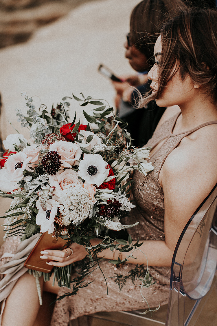 moody anemone bouquets - http://ruffledblog.com/intimate-modern-romantic-wedding-celebration-the-ceremony
