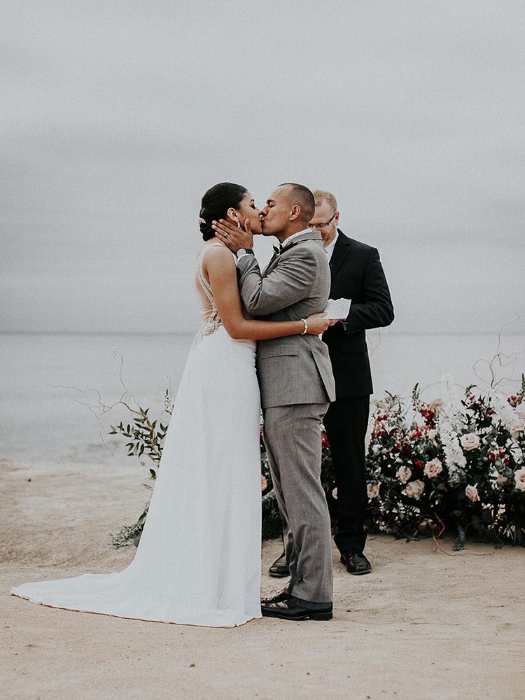 ceremony kiss - https://ruffledblog.com/intimate-modern-romantic-wedding-celebration-the-ceremony