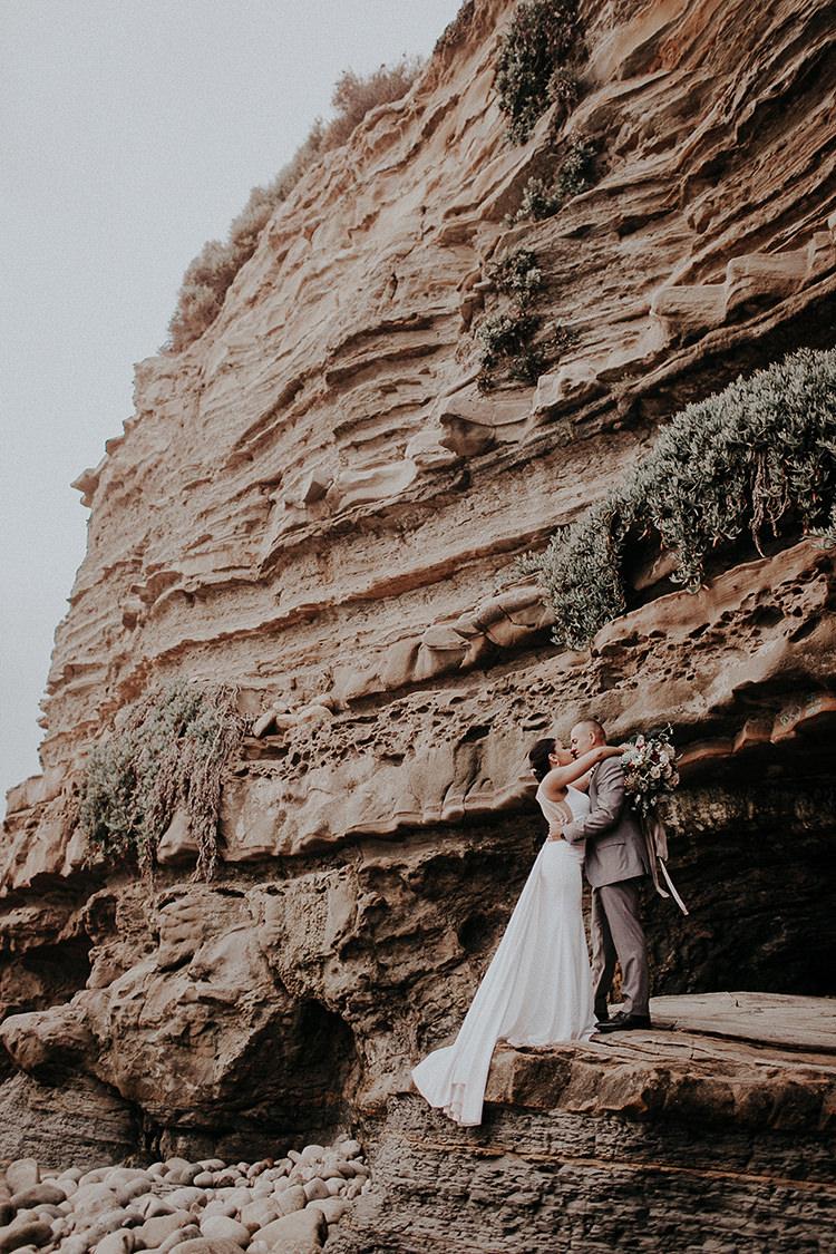 La Jolla Cliffs wedding protraits - https://ruffledblog.com/intimate-modern-romantic-wedding-celebration-the-ceremony