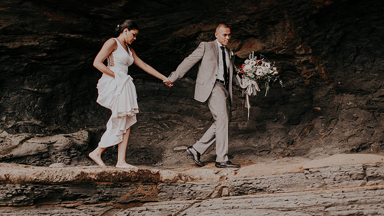 cliffside wedding portraits - https://ruffledblog.com/intimate-modern-romantic-wedding-celebration-the-ceremony