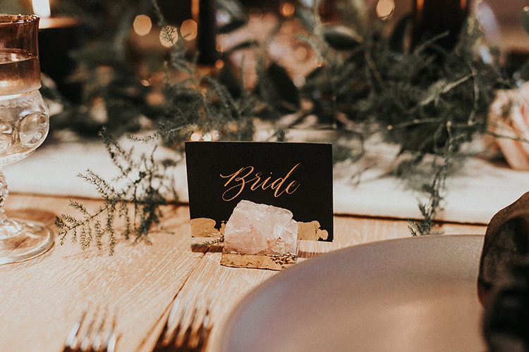gilded amethyst place cards - https://ruffledblog.com/intimate-modern-romantic-wedding-celebration-the-reception