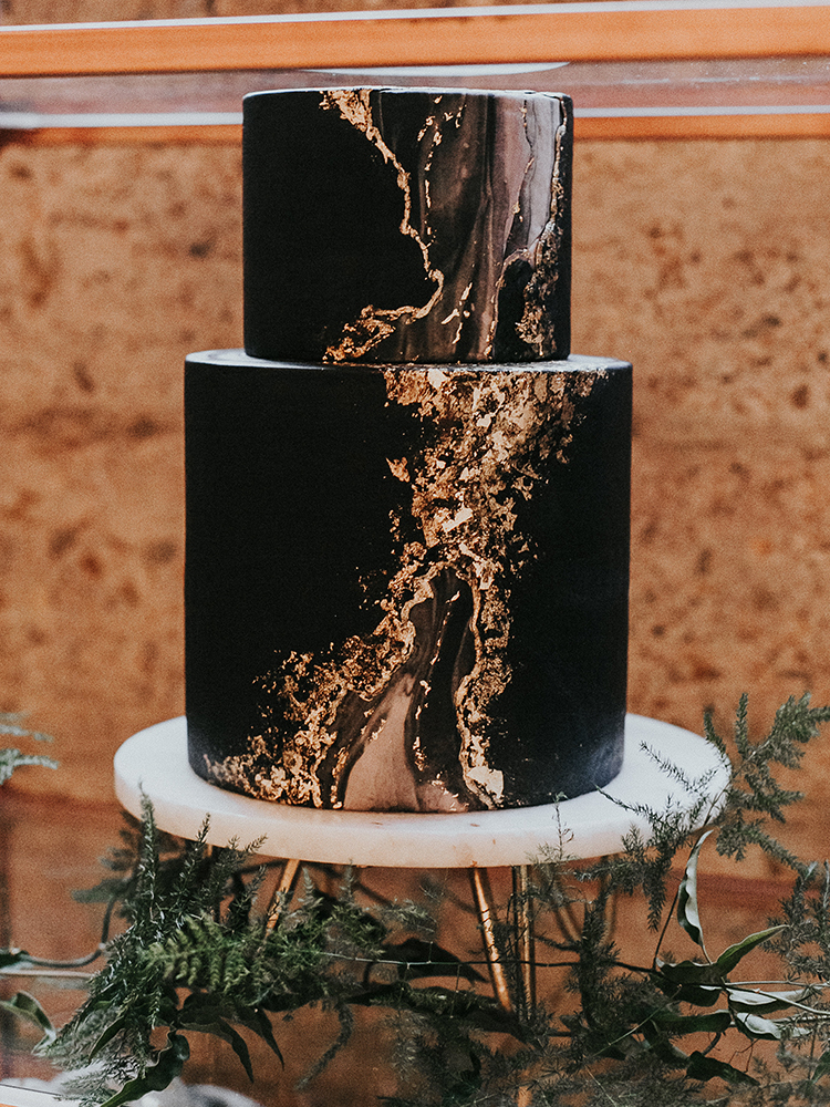 black and gold agate inspired wedding cakes - https://ruffledblog.com/intimate-modern-romantic-wedding-celebration-the-reception
