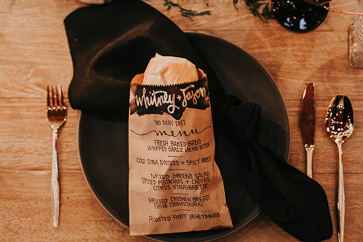 paper bag wedidng menu ideas - https://ruffledblog.com/intimate-modern-romantic-wedding-celebration-the-reception