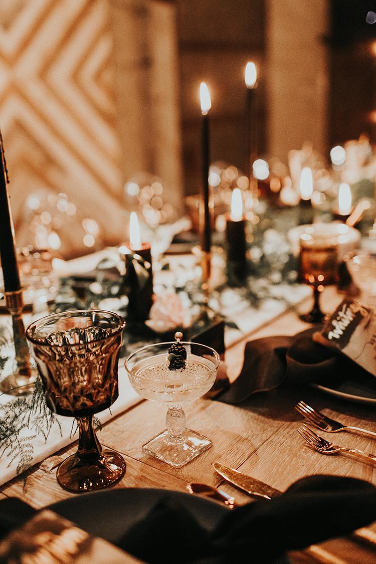 moody tablescape inspo - http://ruffledblog.com/intimate-modern-romantic-wedding-celebration-the-reception