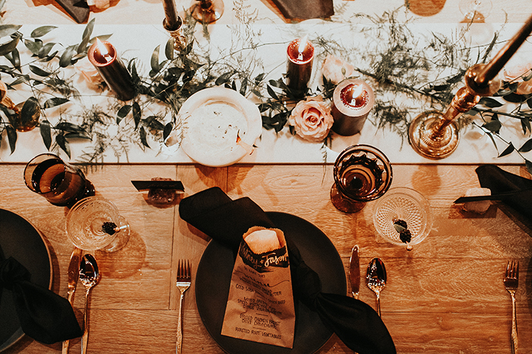 moody winter tablescapes - https://ruffledblog.com/intimate-modern-romantic-wedding-celebration-the-reception