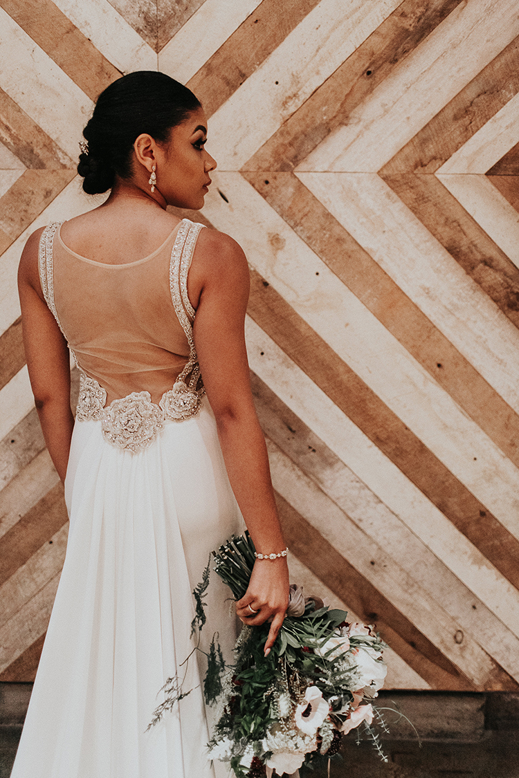 beautiful wedding dress backs - https://ruffledblog.com/intimate-modern-romantic-wedding-celebration-the-reception