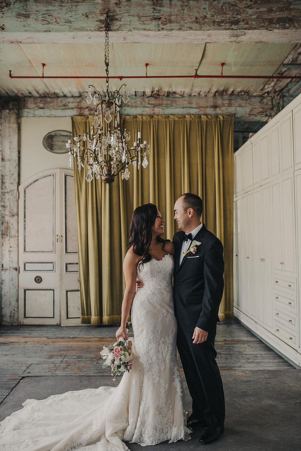 wedding portraits - photo by Loreto Caceres Photography https://ruffledblog.com/intimate-vietnamese-wedding-at-metropolitan-building