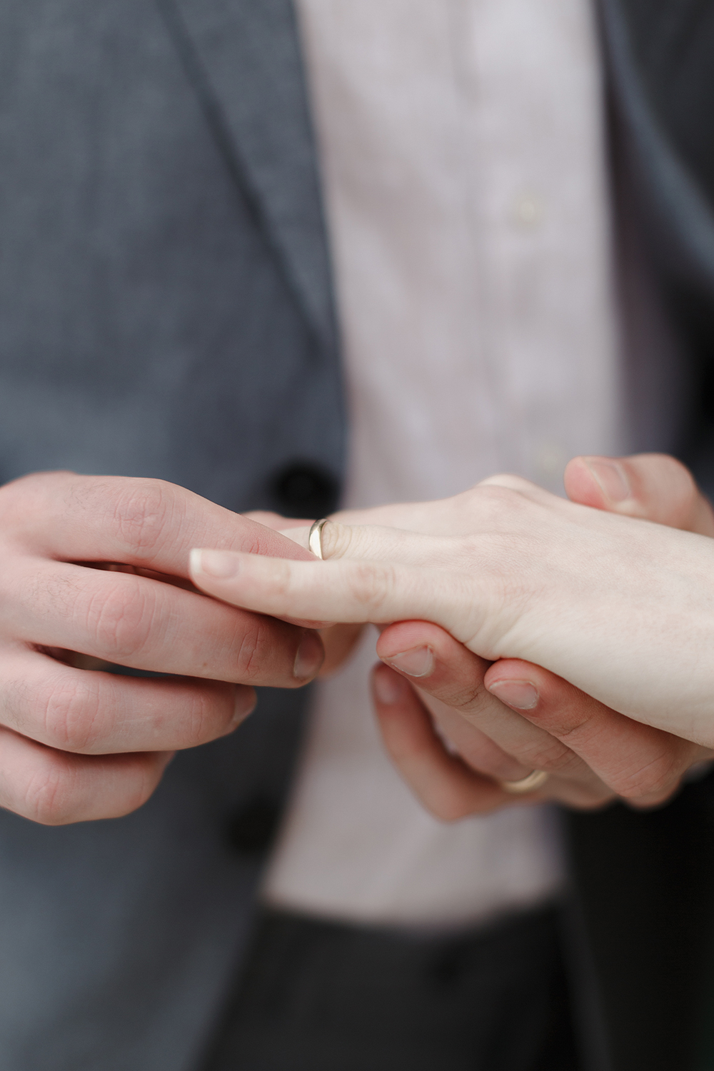 ring exchange - photo by Monica Leggio https://ruffledblog.com/italian-island-elopement-inspiration