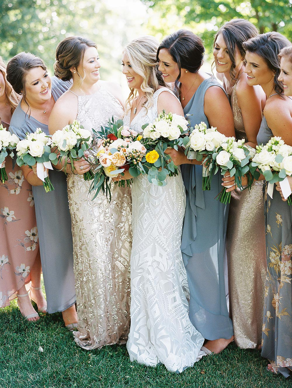 patterned wedding dress with mismatched printed bridesmaid dresses