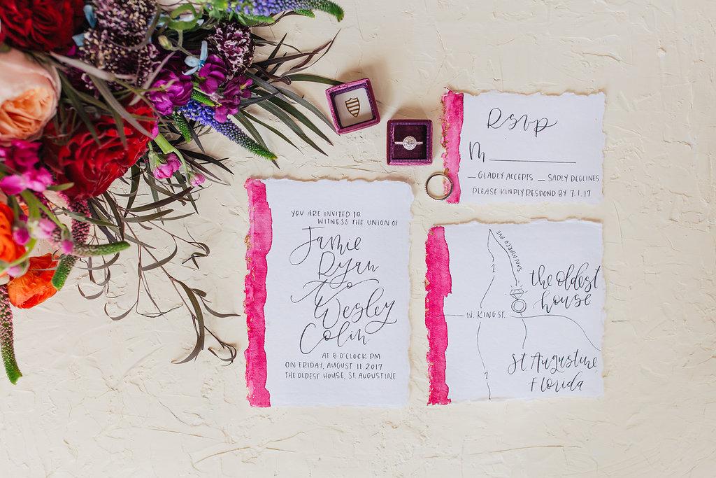 hot pink wedding invitations - photo by Alondra Vega Photography https://ruffledblog.com/jewel-toned-wedding-ideas-with-a-surprise-proposal