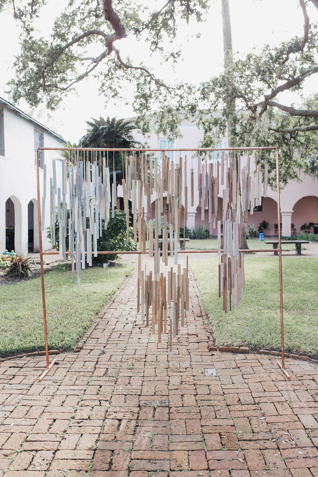 paint stirrer stick backdrops - photo by Alondra Vega Photography http://ruffledblog.com/jewel-toned-wedding-ideas-with-a-surprise-proposal