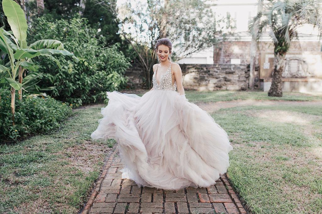 romantic blush wedding dresses - photo by Alondra Vega Photography http://ruffledblog.com/jewel-toned-wedding-ideas-with-a-surprise-proposal