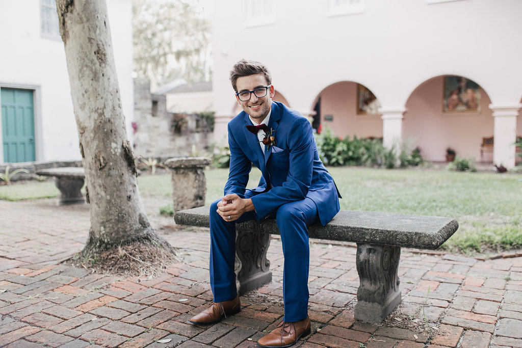 grooms in blue suits - photo by Alondra Vega Photography http://ruffledblog.com/jewel-toned-wedding-ideas-with-a-surprise-proposal