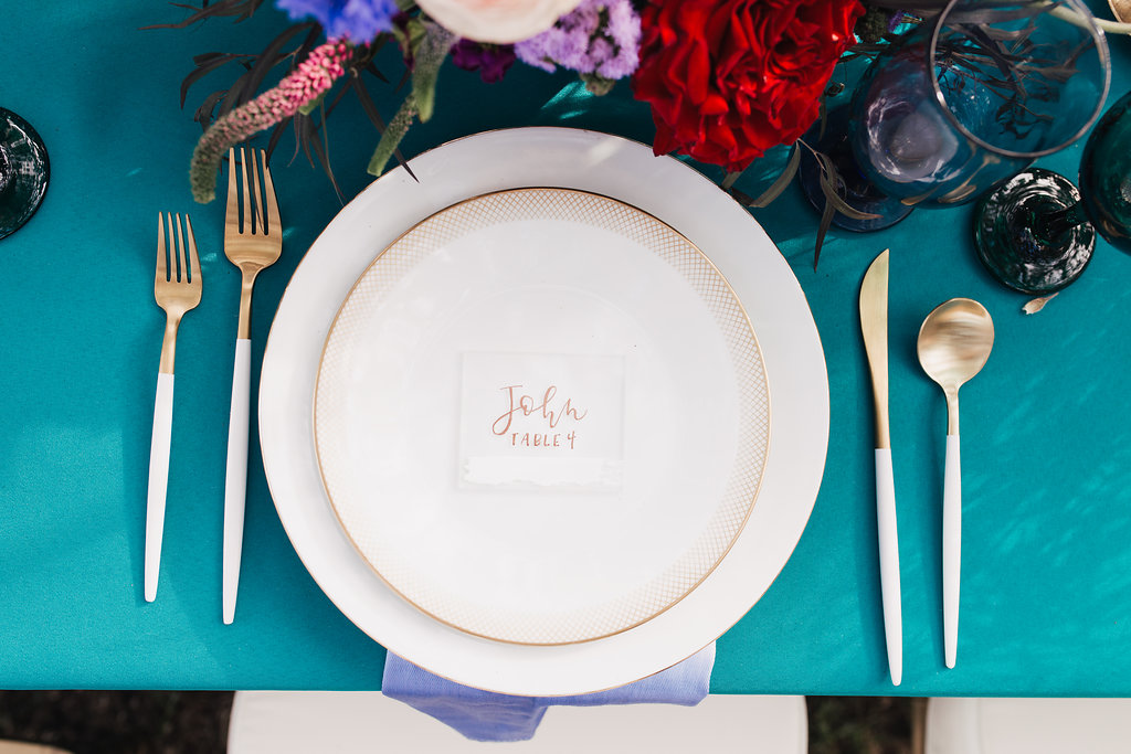 simple classic place settings - photo by Alondra Vega Photography http://ruffledblog.com/jewel-toned-wedding-ideas-with-a-surprise-proposal