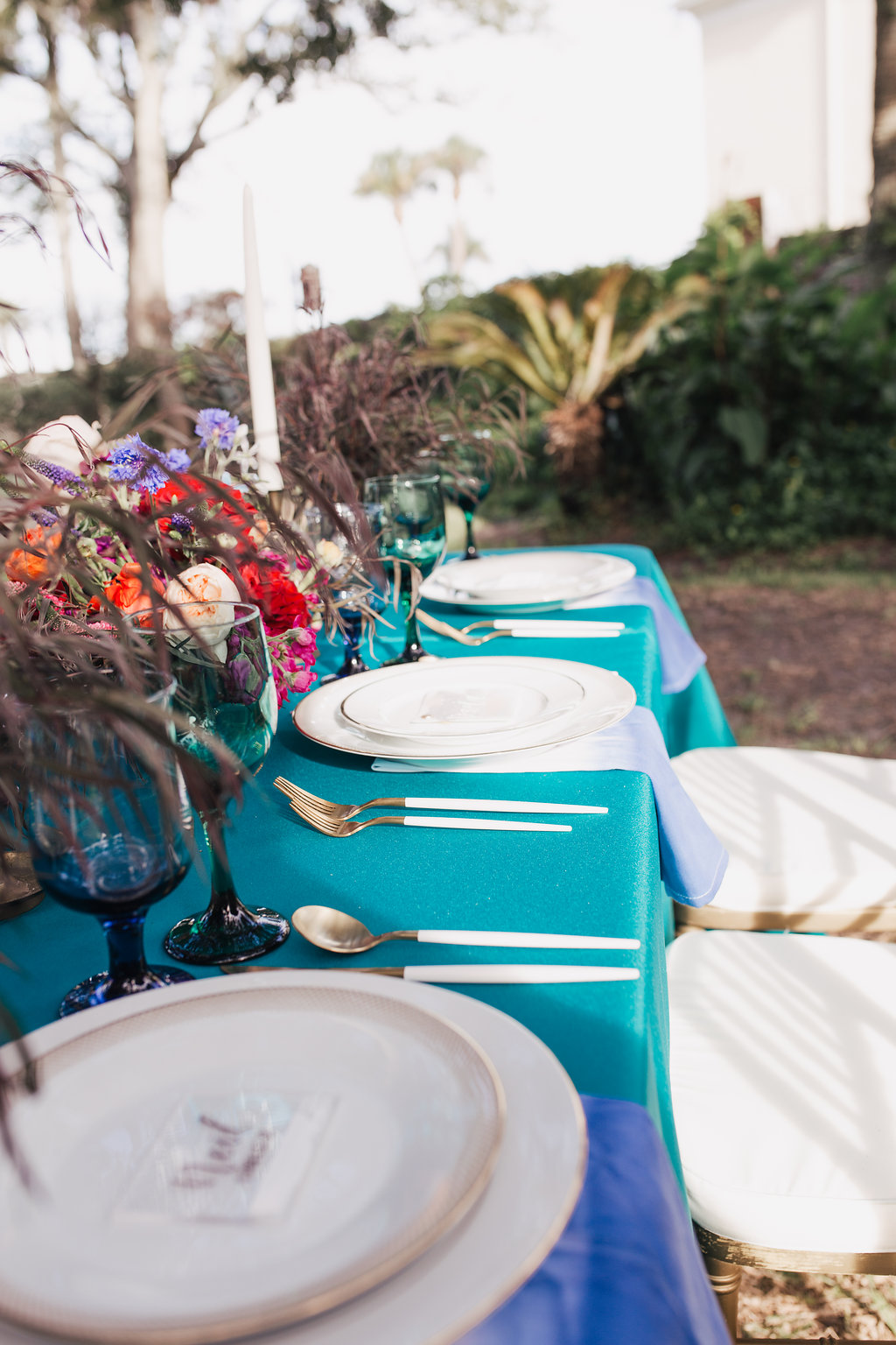 teal at weddings - photo by Alondra Vega Photography https://ruffledblog.com/jewel-toned-wedding-ideas-with-a-surprise-proposal