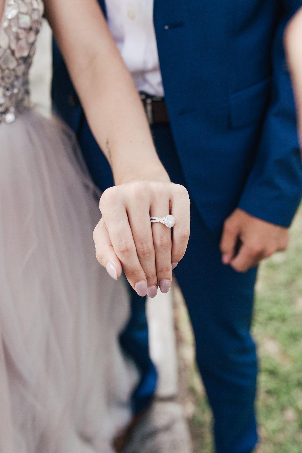 round engagement rings - photo by Alondra Vega Photography https://ruffledblog.com/jewel-toned-wedding-ideas-with-a-surprise-proposal
