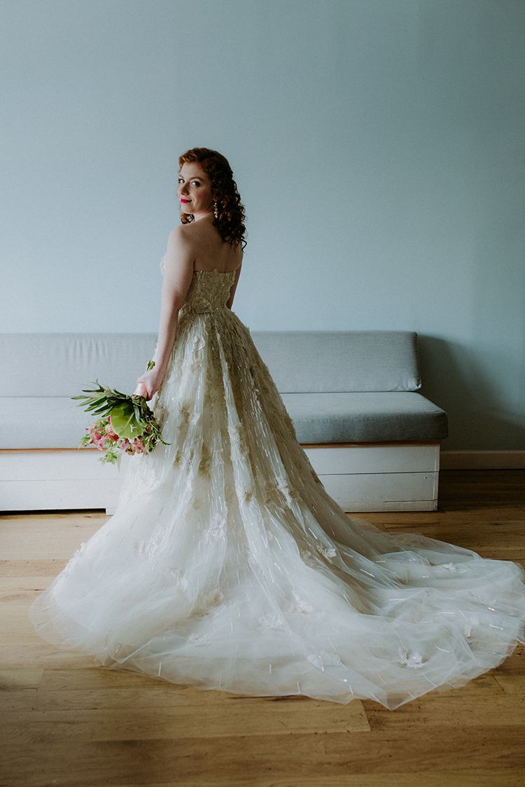 lace strapless wedding gowns - photo by Amber Gress Photography http://ruffledblog.com/jurassic-park-meets-the-golden-girls-for-this-brooklyn-wedding