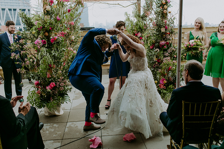 Jewish wedding traditions - photo by Amber Gress Photography https://ruffledblog.com/jurassic-park-meets-the-golden-girls-for-this-brooklyn-wedding