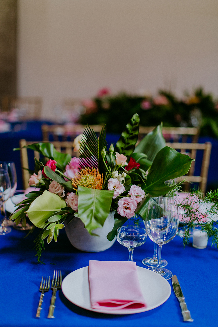 tropical wedding tablescapes - photo by Amber Gress Photography http://ruffledblog.com/jurassic-park-meets-the-golden-girls-for-this-brooklyn-wedding